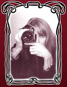 Photo of Linda McCartney with a camera